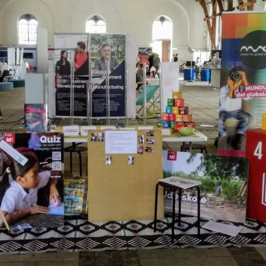 MUNDU stand with leaflets and marketing materials