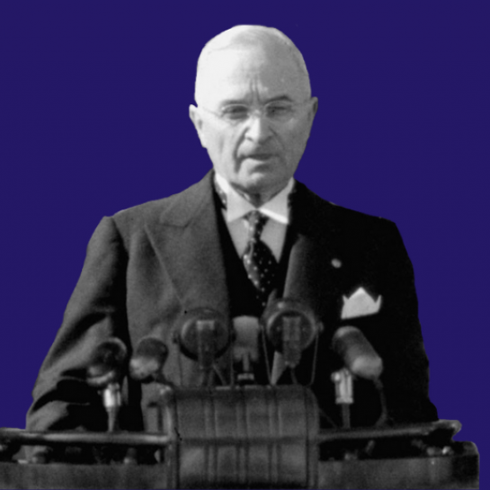 President Harry Truman infront of a purple backdrop